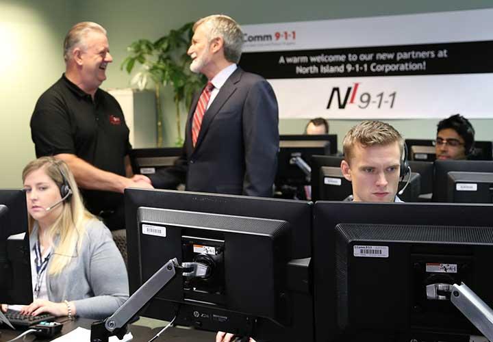 Former NI9-1-1 President Jon Ambler and E-Comm CEO David Guscott