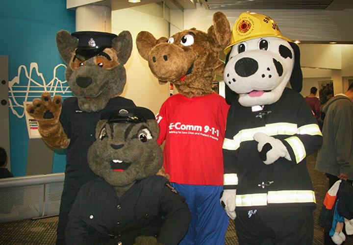 Ali with mascot friends.