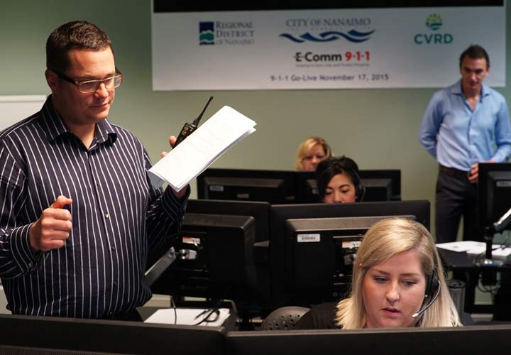 E-Comm staff carry out final preparations before the official 9-1-1 cutover on November 17, 2015.