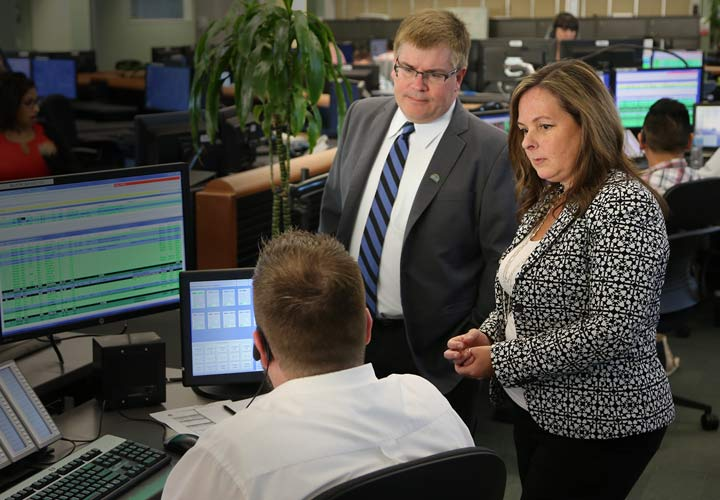 Mayor Mike Clay and Councillor Diana Dilworth get a firsthand look at new Port Moody police dispatch area at E-Comm.