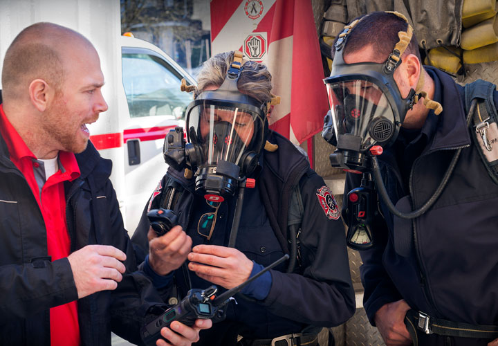 E-Comm's wireless team assists Vancouver Fire and Rescue Services in testing noise cancellation technology when wearing a compressed breathing apparatus.