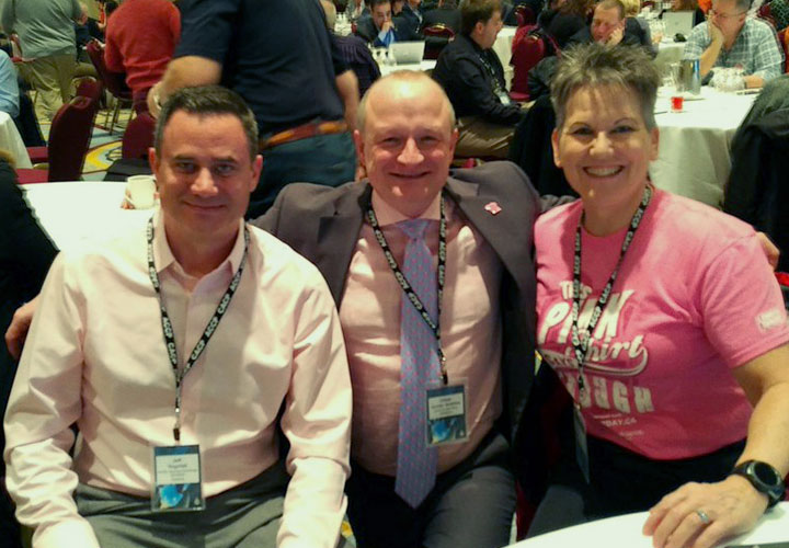 E-Comm President and CEO Oliver Grüter-Andrew (centre) marks Pink Shirt Day at a Canadian Association of Chiefs of Police workshop in Vancouver on February 28.
