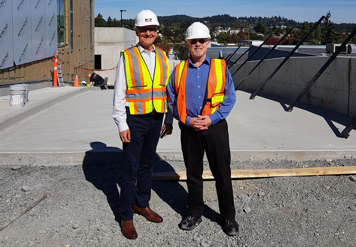 E-Comm Board Chair Doug Campbell and E-Comm Program Manager Brian Ackles during a construction site visit in September.