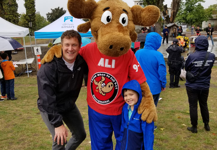 E-Comm's 9-1-1 Moose Ambassador, ALI, connecting with the community and sharing public education messages related to 9-1-1.