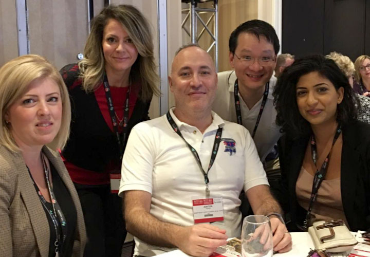 E-Comm employees Gail Oye, Melissa McPherson, Ashton Paradis, Robert Wong and Sandeep Dhillon at the APCO conference in November.