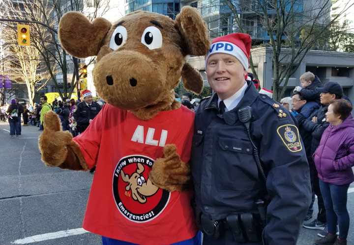 E-Comm's 9-1-1 Ambassador ALI with Vancouver Police Department's Chief Constable Adam Palmer